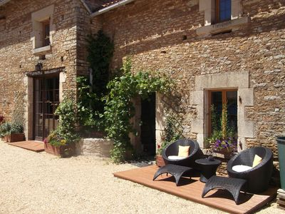Photo for Cottage In Delightful Vendee Medieval Village with  heated swimming pool