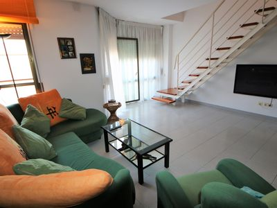 Photo for Beautiful penthouse with terraces, barbecue, pool and parking, 100 m from the beach