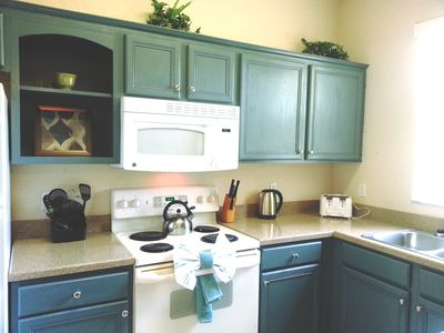 full kitchen ~upgraded cabinets. toaster, tea kettle,  pots, pans, baking dishes