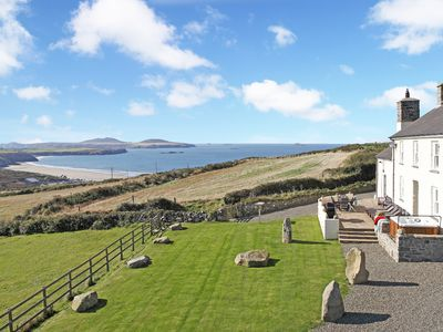 Photo for Stunning sea views, idyllic characterful farmhouse with log burner and jacuzzi