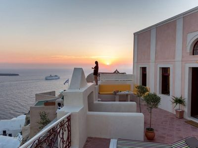 Photo for Mansion Neptune nestled on the famous cliffs of Oia in Santorini, 4 Bedrooms, Up to 7 Guests, exterior jacuzzi, An authentic luxurious house !