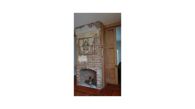 Original fireplace in kitchen (non-working fireplace)