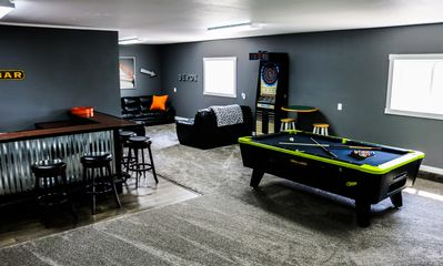 The rec room! You won't want to leave once you get here! Pool, darts, bar, TV...