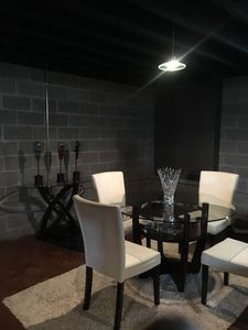 modern style table set. Seating for 4 people for cards, games, drinks.