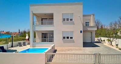 Photo for Holiday house Villa Le Mare - Max. 10 people with pool, sea view and sandy beach