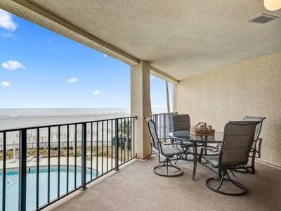 Photo for Charming beachfront condo w/beach access, shared pool, and great water views!