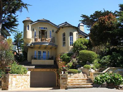 Ocean view tri level home with 2 car garage, elevator and lovely gardens.