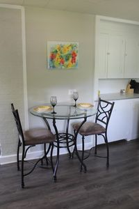 Table offers seating for two and easily seats up to 4. Extra chairs available