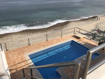 Photo for Spectacular private beachfront home steps from downtown & the Malecon