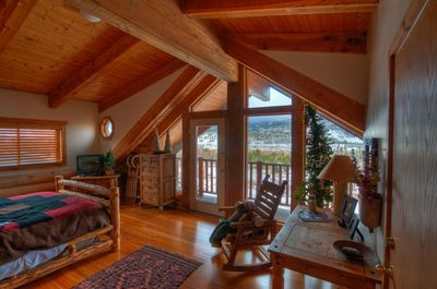 Vaulted ceilings and mountain views make our master bedroom a welcome reprieve.
