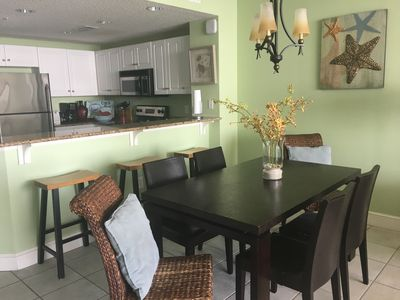 Dining and Kitchen with additional bar stool seating