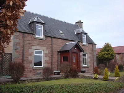 Photo for A century-old stone farmhouse with private garden and great views of Inverness