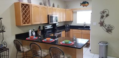 Fully equipped kitchen, granite counter tops and stainless steel appliances.