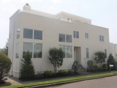 Photo for DELUXE Margate Beach Home with POOL, JACUZZI, & Spectacular Bay View - Sleeps 18