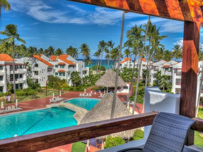Photo for Exquisite Ocean and pool view Apartment next to the beach