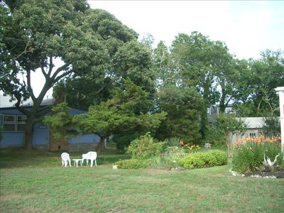 Over-sized lot with flower beds