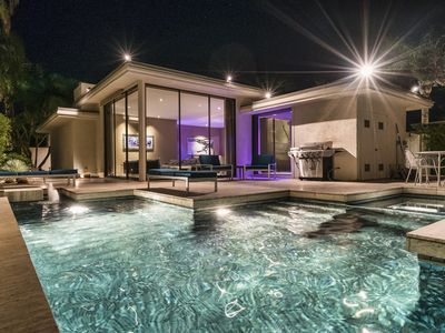 Elrod Villa by night: Get ready to party like it's 1975! Hot gas BBQ, cool pool.