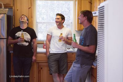 Boys relaxing in the Guest House Kitchen.