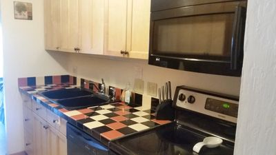 Kitchen, full size stove, cupboards well stocked.