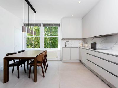 Photo for Bright Modern Minimalist 4BR house with garden next to Greenwich Park, by Veeve