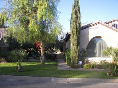 Photo for Cozy home across st from Coachella grounds w/access to 3 pools & golf course