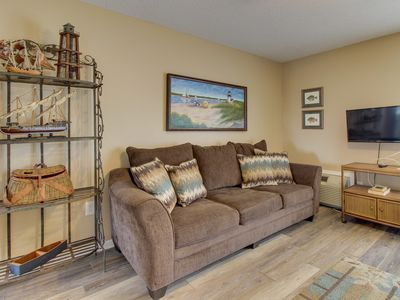 Photo for NEW LISTING! Comfortable condo w/ water views & shared pool - walk to the beach!