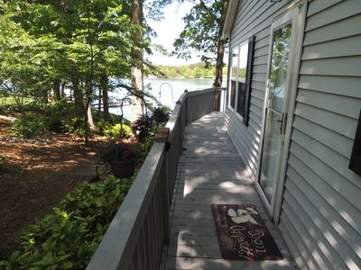 Photo for Private Lake Cottage on the water with fireplace, with boat dock and huge deck!