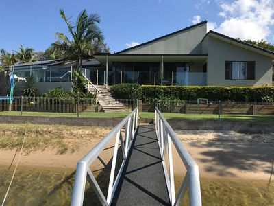 Photo for ENJOY THE SPECTACULAR WATER FRONT VIEWS FROM THE COVERED PATIO