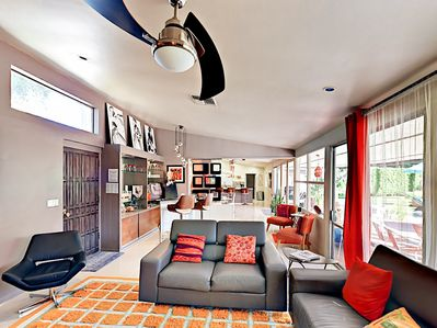 Living Area - Tall canted ceilings and sliding glass patio doors make the great room a perfect gathering place.