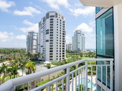 Photo for *Sunset Views and Walk to the Beach from this 3rd Floor Bay Shore Place Condo!*