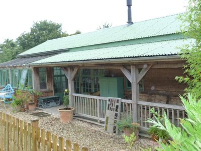 Photo for The Garden Room. Timber framed, light and airy accommodation with veranda.