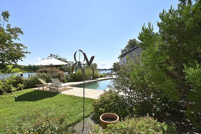 Pool with water views, beautiful art throughout the property!