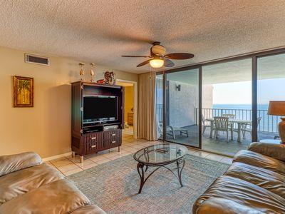 Photo for Waterfront beach condo w/ pool, hot tub & tennis available - balcony!