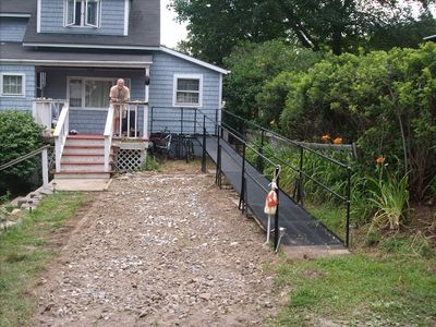 The driveway is off a dead-end street with room for two cars. There's a ramp.