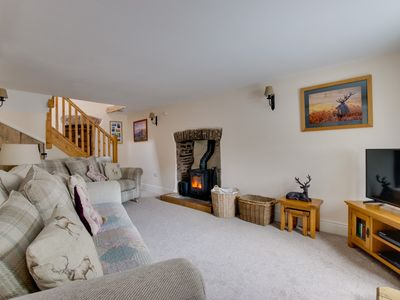 Photo for 5 star cosy luxurious 300 year old Welsh stone cottage located in the quiet village of Trecastle in