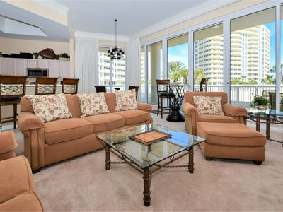 Photo for Lobby-Level End Unit: Patio Access to Beach and Pool. Free Beach Chair Service!