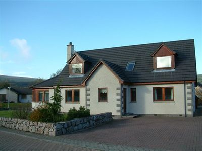 Photo for Craigmore Lodge, Aviemore: sleeps up to 14 with hot tub, sauna, wifi and more