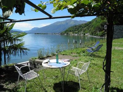 Photo for Apartment with large garden is located right on the lake and has a beautiful view