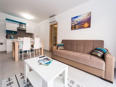 Photo for Holiday apartment near the sea with air conditioning in all rooms