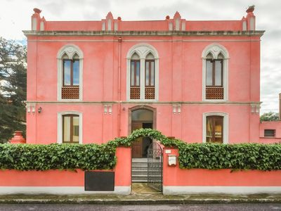 Photo for The Pink Palace - Apartment Il Tramonto, 100m from a sandy beach