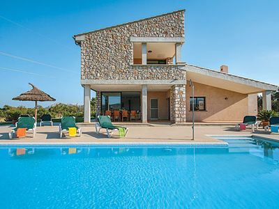 Photo for Stone-clad villa w/ panoramic country views, pool, lawn + terrace