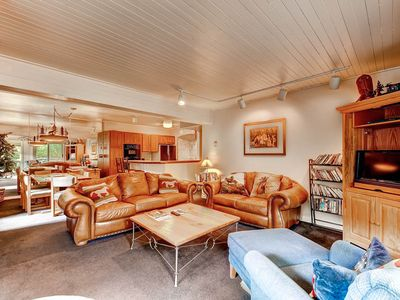 Ski-in condo with shared hot tub steps to gondola