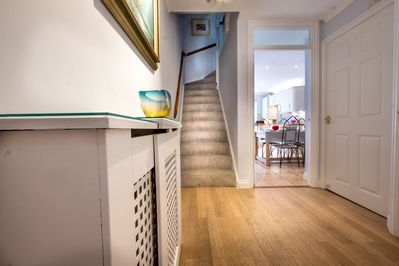 The welcoming hallway leading to the kitchen and family room.