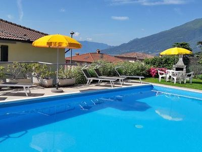 Photo for Apartment Il Bosso 204 with large terrace and pool. Just 100 meters from the lake