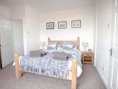 Photo for Beautiful, spacious 2 bedroom holiday house with parking and sea views.