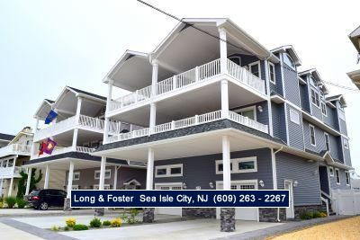 Photo for LARGE deck - Enjoy the spectacular views of the ocean & sunsets over the back bay