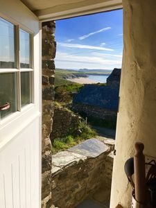 Photo for Cosy Cottage with stunning coastal views at the foothill of Carn Llidi mountain