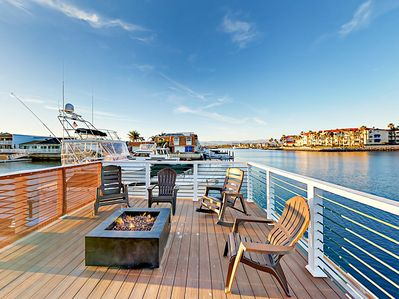 Deck - Welcome to your home in Oxnard! Gather at the fire pit and enjoy the harbor views on your private deck.