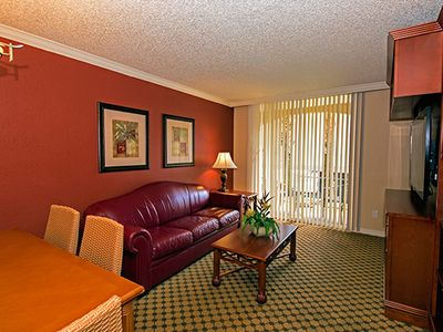 Photo for Family-Friendly Villa Two Miles from Disney w/ Resort Pool, Full Kitchen & WiFi