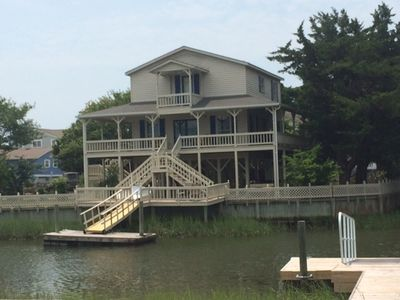 Photo for Beautiful wraparound porch,  new boat dock, water on two sides, secluded,